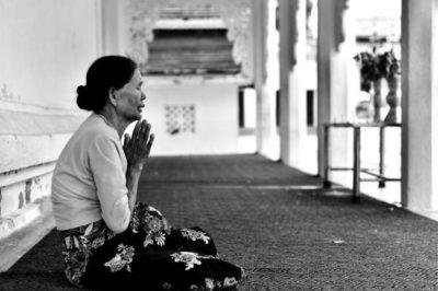 Broken Asian Woman Praying